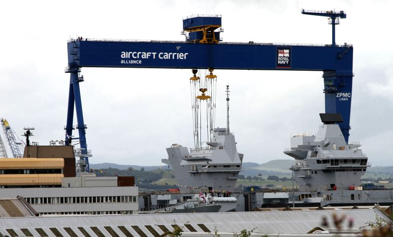 Photo taken on July 4, 2014 shows the Royal Navy warship HMS Queen Elizabeth at the Rosyth Dockyard in Rosyth, Britain. The Queen Elizabeth II on Friday officially ...