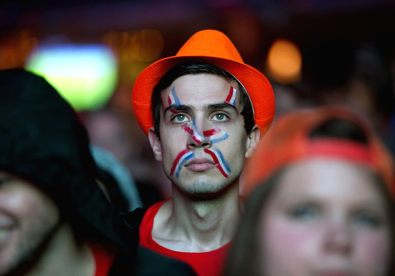A fan watches the televised World Cup semi-final between the Netherlands and Argentina, in Rotterdam, the Netherlands, on July 9, 2014.