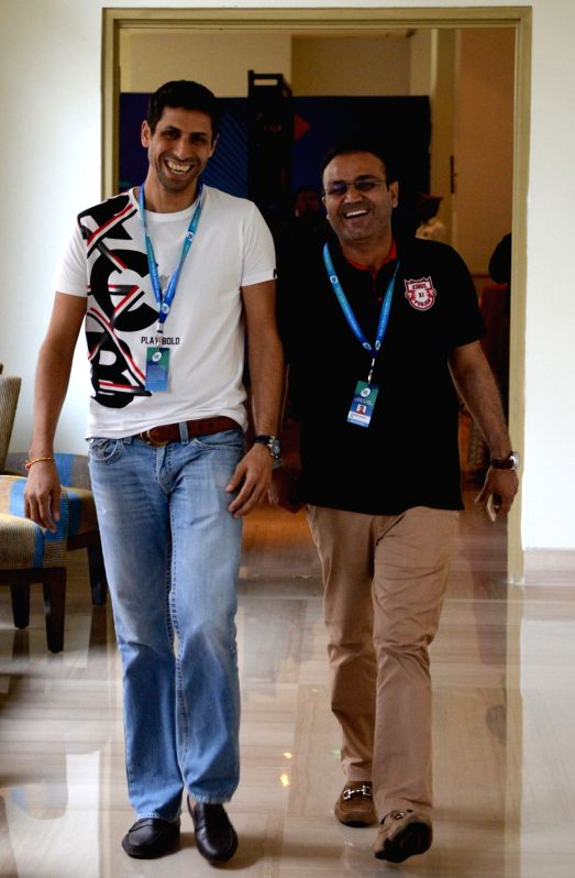 Royal Challengers Bangalore bowling coach Ashish Nehra and Kings XI Punjab team director Virender Sehwag during the second day of Indian Premier League (IPL) Players' Auction in Bengaluru ... - Virender Sehwag and Ashish Nehra