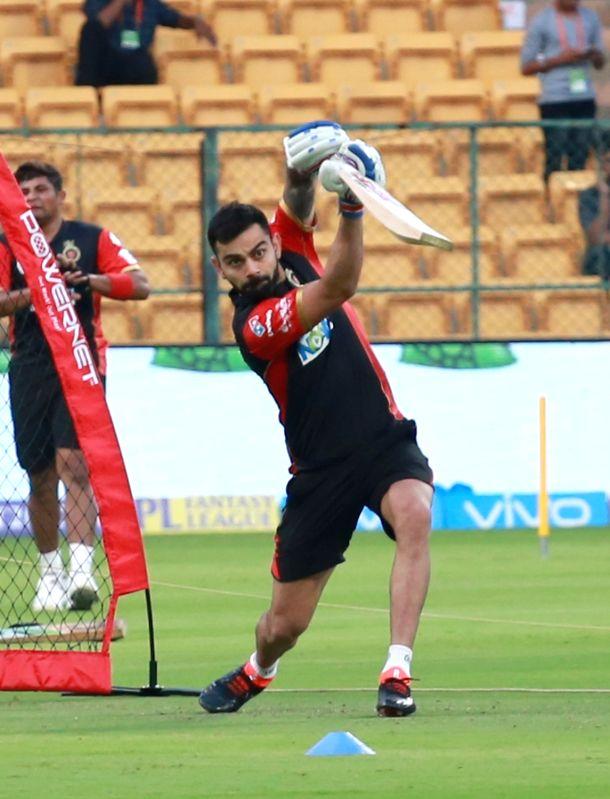 Royal Challengers Bangalore captain Virat Kohli during a practice session at M. Chinnaswamy Stadium in Bengaluru on April 12, 2018. - Virat Kohli