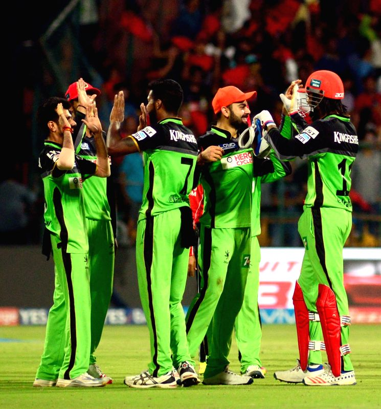 Royal Challengers Bangalore celebrate after winning an IPL match between Royal Challengers Bangalore and Gujarat Lions at Bangalore at M Chinnaswamy Stadium in Bengaluru on May 14, 2016.