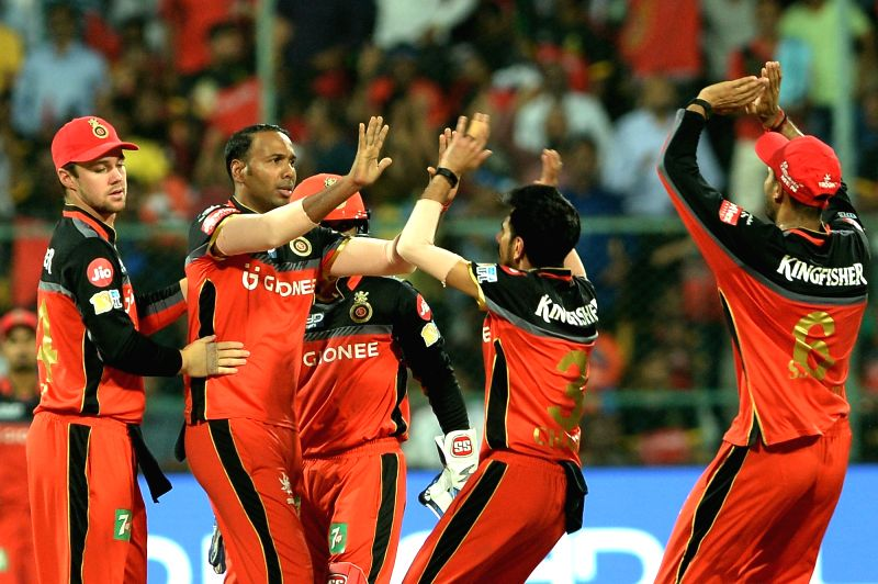 Royal Challengers Bangalore celebrate fall of a wicket during an IPL 2017 match between Gujarat Lions and Royal Challengers Bangalore at M Chinnaswamy Stadium in Bengaluru on April 27, ...