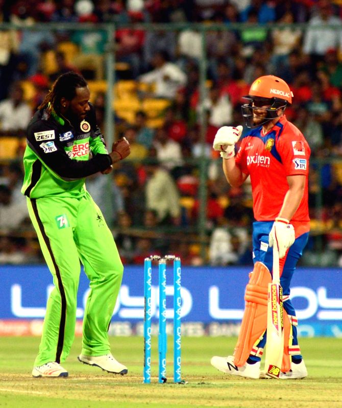 Royal Challengers Bangalore player Chris Gayle celebrate fall of a wicket during an IPL match between Royal Challengers Bangalore and Gujarat Lions at Bangalore at M Chinnaswamy Stadium in ...