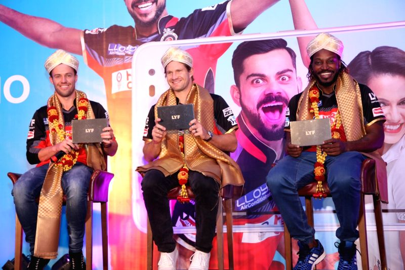 Royal Challengers Bangalore players AB De Villiers, Shane Watson and Chris Gayle during a promotional event in Bengaluru on May 13, 2016.