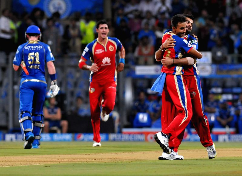 Royal Challengers Bangalore players celebrate fall of Ben Dunk's wicket during the 27th match of IPL 2014 between Mumbai Indians and Royal Challengers Bangalore at Wankhede Stadium in Mumbai on May ..