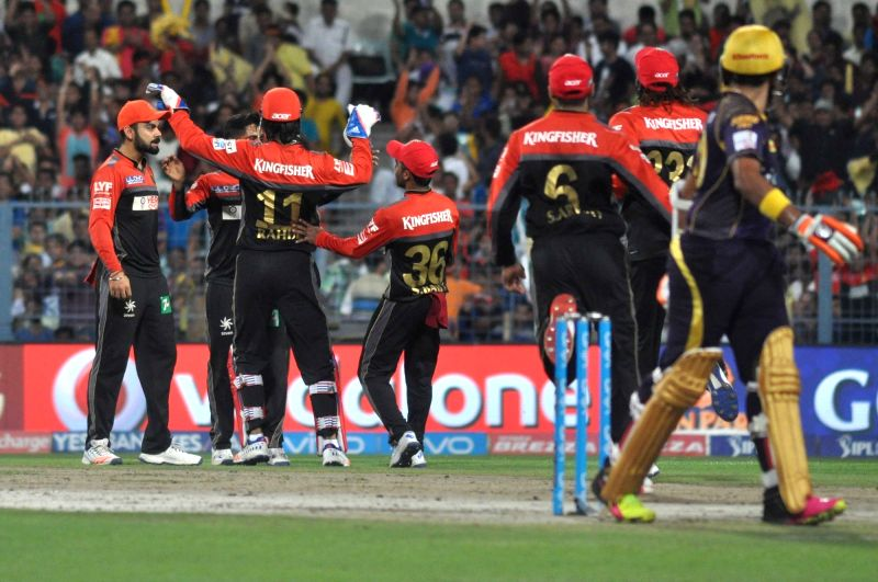 Royal Challengers Bangalore players celebrate fall of a wicket during an IPL match between Kolkata Knight Riders and Royal Challengers Bangalore in Kolkata, on May 16, 2016.