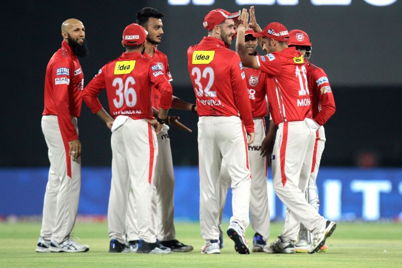 Royal Challengers Bangalore players celebrate fall of Shane Watson's wicket during an IPL 2017 match between Kings XI Punjab and Royal Challengers Bangalore at Holkar Cricket Stadium in ...