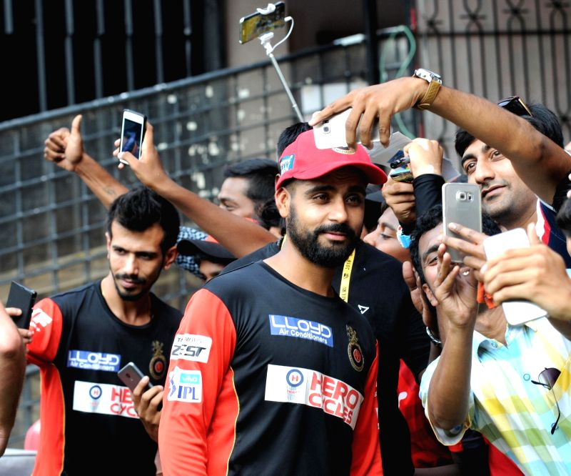 Royal Challengers Bangalore players Yuzvendra Chahal and Mandeep Singh at Chinnaswamy Stadium, in Bengaluru on May 13, 2016. - Mandeep Singh