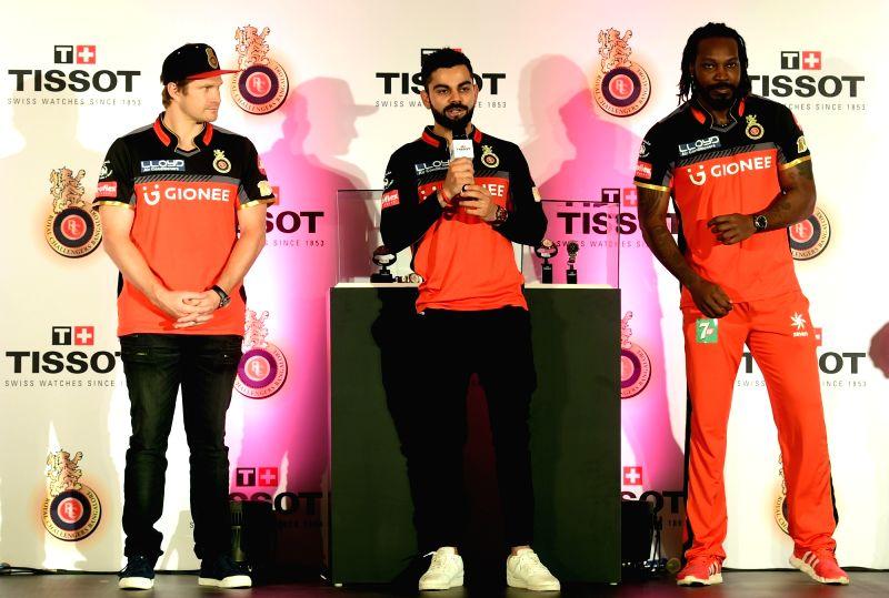 Royal Challengers Bangalore (RCB) skipper Virat Kohli, Shane Watson and Chris Gayle during a promotional event in Bengaluru on May 10, 2017. - Virat Kohli