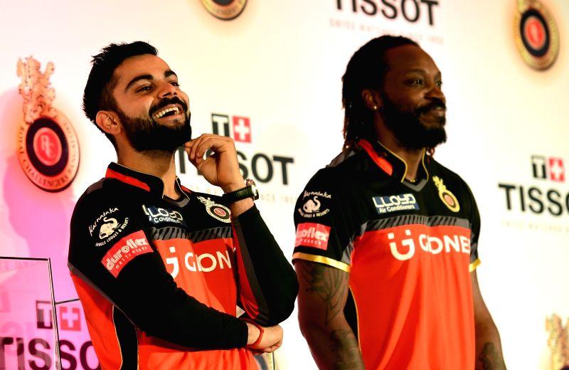 Royal Challengers Bangalore (RCB) skipper Virat Kohli and Chris Gayle during a promotional event in Bengaluru on May 10, 2017. - Virat Kohli