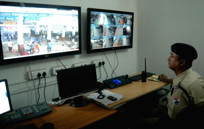 RPF Jawan monitors Guwahati Railway Station through CCTV in light of Home Ministry's alert regarding probable terror attacks in the run-up to Independence Day, on Aug 12, 2014.