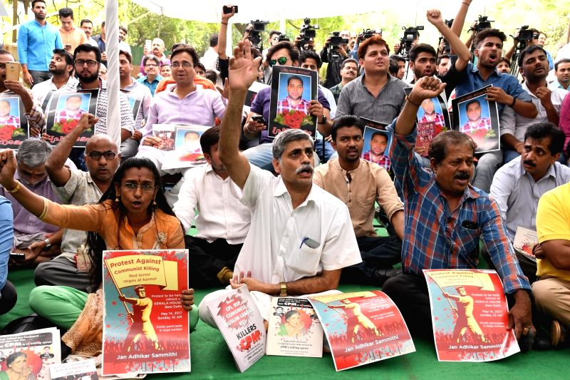 RSS volunteers and BJP workers stage a demonstration near Kerala House against the death of RSS worker Choorakad Biju, in New Delhi on May 14, 2017. 26 year old Biju was hacked to death ...