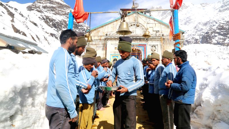 Uttarakhand policemen and the personnel from the National Institute of Mountaineering (NIM) celebrate Mahashivratri at Kedarnath in Rudraprayag district of the state on Feb 17, 2015.