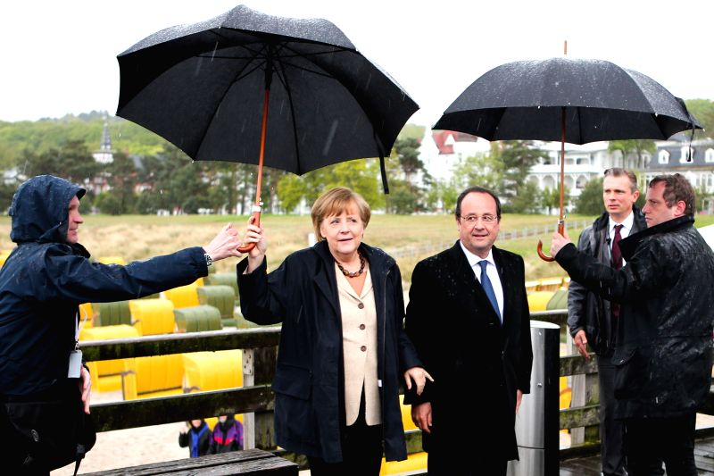 RUEGEN (GERMANY), May 9, 2014 German Chancellor Angela Merkel (2nd L) and visiting French President Francois Hollande (3rd L) pose for photos on the Baltic Sea island of Ruegen, Germany, .