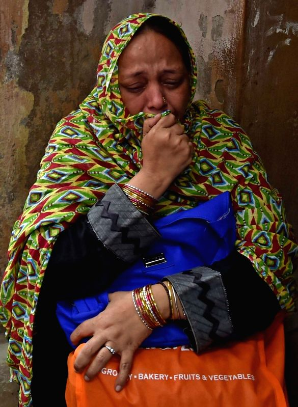 Ruksana,  wife of  Zafar Khan who has been arrested by the Special Task Force (STF) of Kolkata Police for allegedly working for Pakistani spy agency Inter-Services Intelligence (ISI) in ... - Zafar Khan