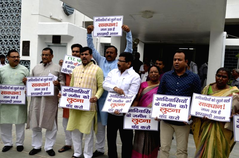 Ruling party legislatures demonstrate against those disturbing the proceeding of the house during the Monsoon session of the Jharkhand Assembly in Ranchi on July 27, 2016.