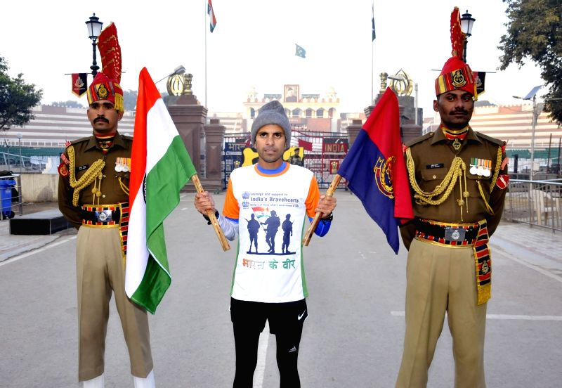 "Runner Samir Singh participates in ""Bharat Ke Veer Ultra Marathon 2017"" at Attari-Wagha border in Punjab on Dec 1, 2017. - Samir Singh"