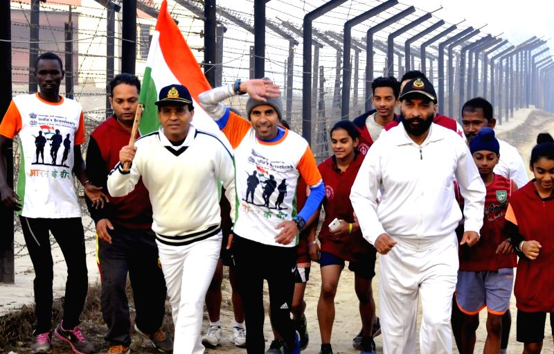 "Runner Samir Singh participates in ""Bharat Ke Veer Ultra Marathon 2017"" at Attari-Wagha border in Punjab on Dec 1, 2017. (Photo: IANS) saEvent: (011217) Attari: ""Bharat Ke Veer ... - Samir Singh"