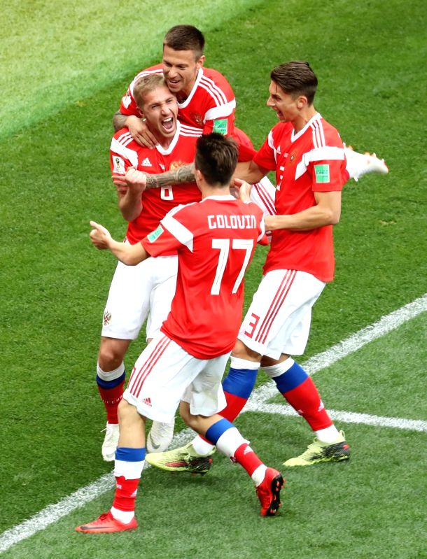 Russian players rejoice after scoring the first goal during the opener of the World Cup against Saudi Arabia at Luzhniki Stadium in Moscow on June 14, 2018. Russia routed Saudi Arabia 5-0.