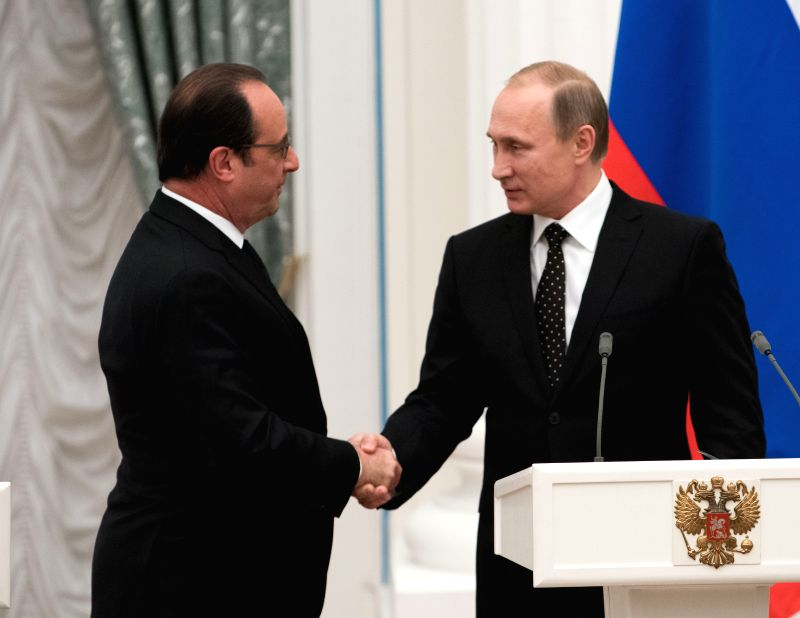 Russian President Vladimir Putin (R) and his French counterpart Francois Hollande hold a joint press conference after their meeting in Kremlin, Moscow, Russia, on ...