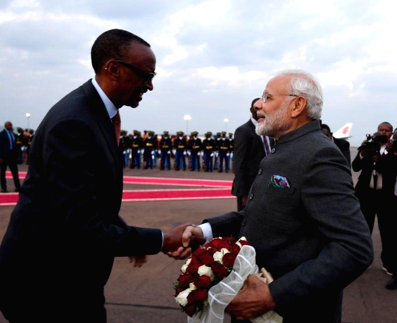 Rwanda President Paul Kagame receives Prime Minister Narendra Modi on his arrival at Kigali International Airport in Rwanda on July 23, 2018. - Narendra Modi