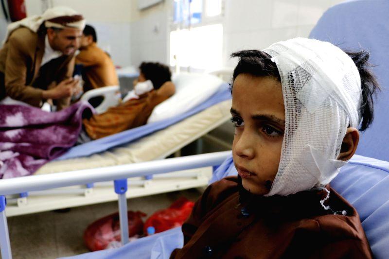SAADA, Aug. 12, 2018 - Children injured in an airstrike receive medical treatment in a hospital in Saada, Yemen, Yemen, on Aug. 12, 2018. Warplanes of the Saudi-led coalition targeted passenger buses ...