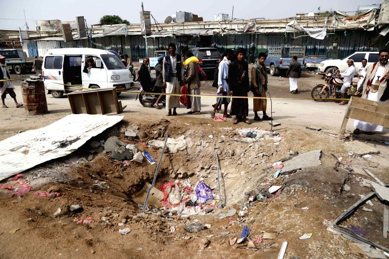 SAADA, Aug. 12, 2018 - People gather at the site of an airstrike in Dhahyan, Saada province, Yemen, on Aug. 12, 2018. Warplanes of the Saudi-led coalition targeted passenger buses in the Dhahyan ...