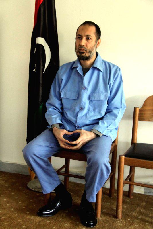 Saadi Gaddafi, son of Muammar Gaddafi, sits at a prison in Tripoli, Libya, Dec. 6, 2015. Saadi faced charges of killing and repressing demonstrators during the 2011 ...