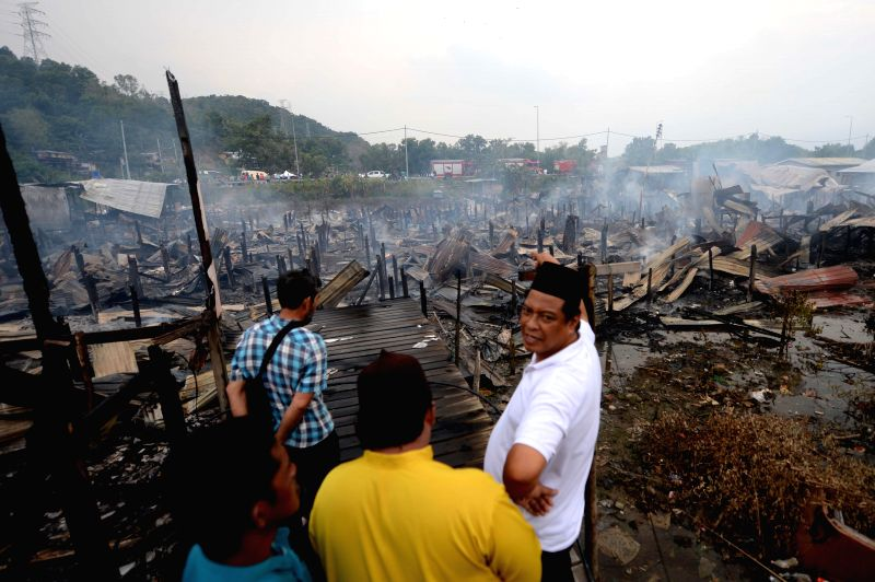 Photo taken on July 29, 2014 shows the scene of a fire at an island some 40 km away from Kota Kinabalu, the capital of Sabah, Malaysia. One died, 200 people lost ...
