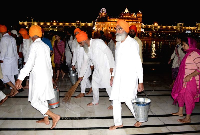 Sabat Surat' -with unshorn hair- Sikh leaders clean Golden Temple in Amritsar on April 27, 2017 Akal Takht had pronounced atonement upon them for taking help from Dera Sacha Sauda ahead of ...