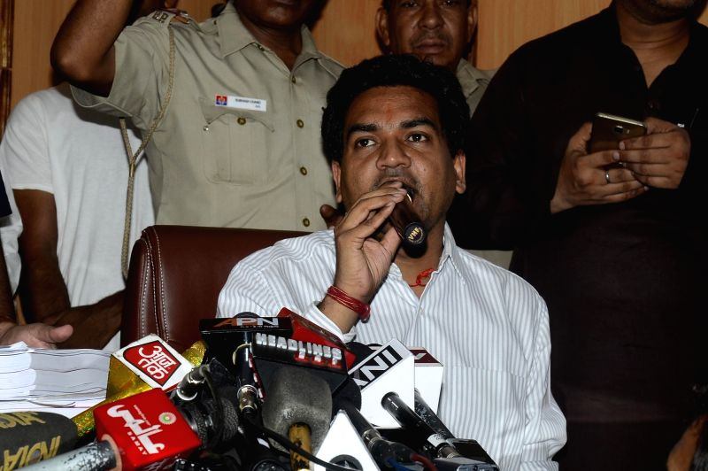 Sacked Delhi Minister Kapil Mishra addresses a press conference in New Delhi on May 14, 2017. Mishra, is on hunger strike since Wednesday demanding that Chief Minister Arvind Kejriwal ... - Kapil Mishra and Arvind Kejriwal