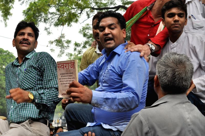 Sacked Delhi Minister Kapil Mishra stages a demonstration against Chief Minister Arvind Kejriwal at his residence in New Delhi, on June 9, 2017. Mishra, accompanied by a parent of deceased ... - Kapil Mishra and Arvind Kejriwal