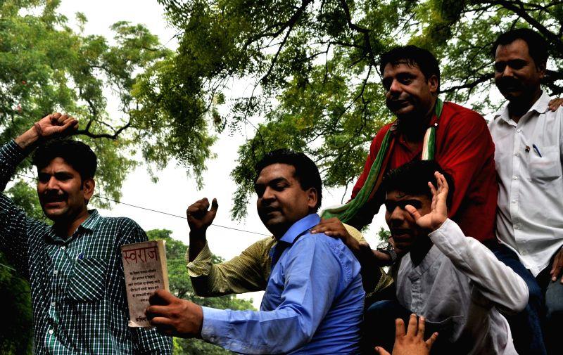 Sacked Delhi Minister Kapil Mishra stages a demonstration against Chief Minister Arvind Kejriwal at his residence in New Delhi, on June 9, 2017. Mishra, accompanied by a parent of deceased ... - Kapil Mishra and Arvind Kejriwal
