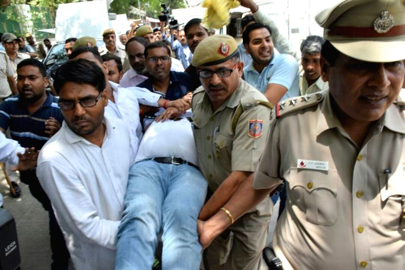 Sacked Delhi Minister Kapil Mishra who fainted during a press conference being rushed to hospital for treatment in New Delhi on May 14, 2017.Mishra, is on hunger strike since Wednesday ... - Kapil Mishra and Arvind Kejriwal