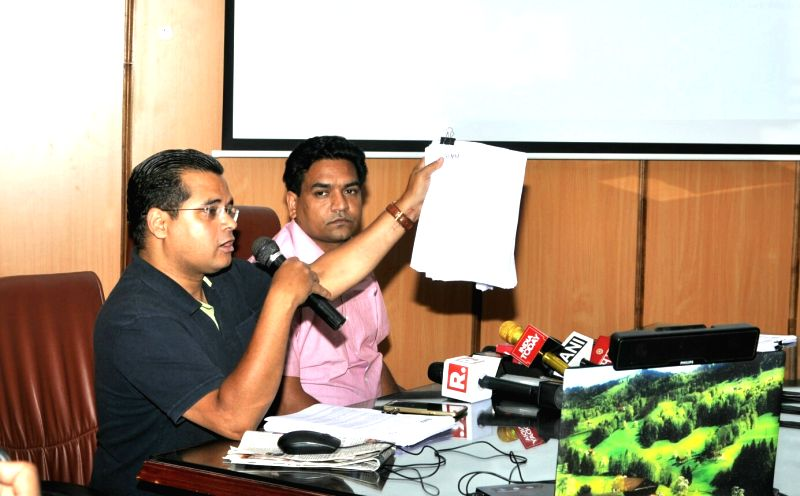 Sacked Delhi Minister Kapil Mishra with anti corruption activist Neil Terrance Haslam addressing a press conference in New Delhi on June 12, 2017. - Kapil Mishra