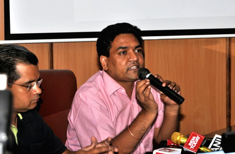 Sacked Delhi Minister Kapil Mishra with anti corruption activist Neil Terrance Haslam addressing a press conference in New Delhi on June 12, 2017. - Kapil Mishra