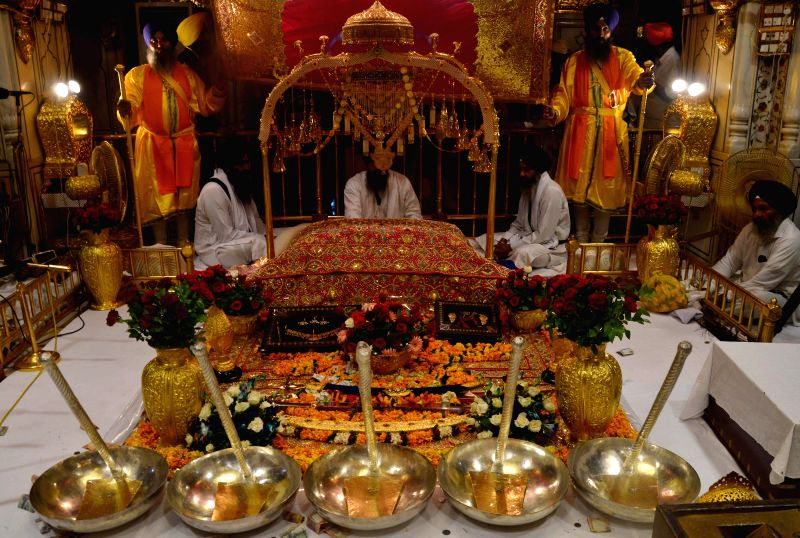 Sacred symbols of  Sikhism's on display inside the Golden Temple on Parkash Utsav of Sri Guru Granth Sahib (410th anniversary of installation of the Guru Granth Sahib) in Amritsar on Sept 1, 2014.