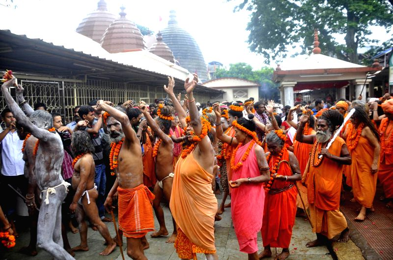 Sadhus from different parts of India praying and chanting mantras and devotional songs in the premises of Kamakhya temple on the eve of Ambubachi mela 2014 in Guwahati on June 21, 2014.