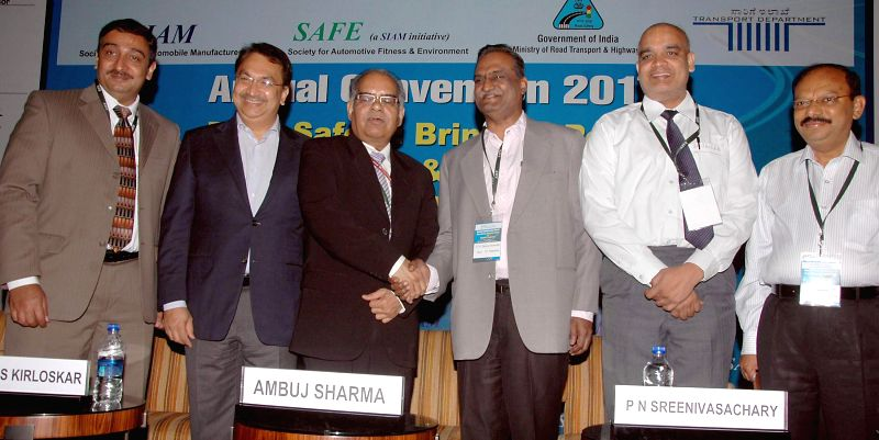 "SAFE (Society for Automotive Fitness and Environment) Vice President Dr. Venkat Srinivas with SIAM President Vikram S Kirloskar and others a programme on ""Road Safety - Bringing Policy and ..."