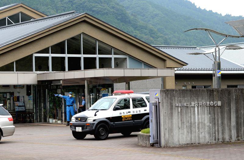 SAGAMIHARA, July 26, 2016 - Police officers work outside of the Tsukui Yamayuri-en (Tsukui Lily Garden) care facility in Sagamihara City, Japan's Kanagawa Prefecture, July 26, 2016. Following a fatal ...