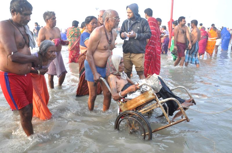 Almost 20 lakh devotees take holy dip on Makar Sankranti