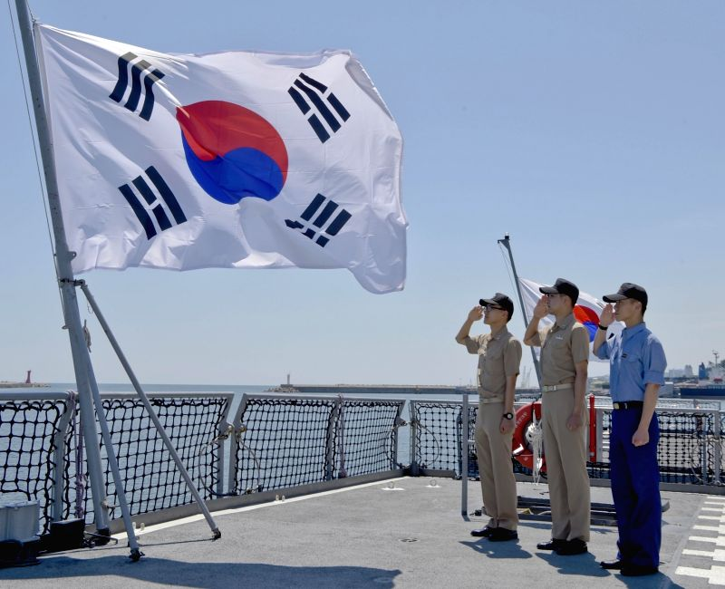 Sailors of South Korea's First Naval Fleet salute the national flag while pledging to strongly protect the country's East Sea on June 5, 2016, one day ahead of Memorial Day.
