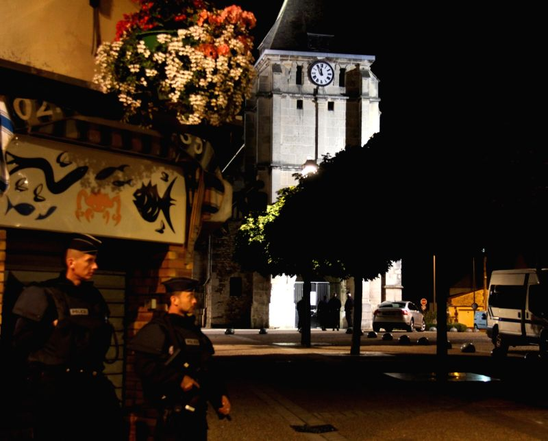 SAINT-ETIENNE-DU-ROUVRAY (FRANCE), July 27, 2016 French police stand guard near the church which was attacked in Saint-Etienne-du-Rouvray, Seine-Maritime department, France, July 26, ...