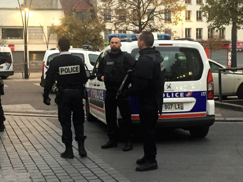 SAINT-French policemen block roads near the area of an anti-terrorist police assault in northern Paris suburbs Saint-Denis, France, on Nov. 18, 2015. An ...