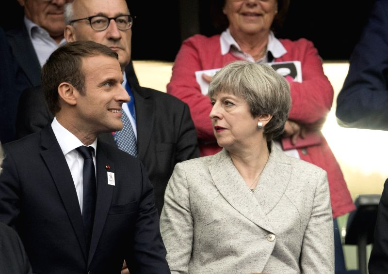 SAINT-French President Emmanuel Macron (L) and British Prime Minister Theresa May attend the international friendly match between France and England at the Stade de ... - Theresa May