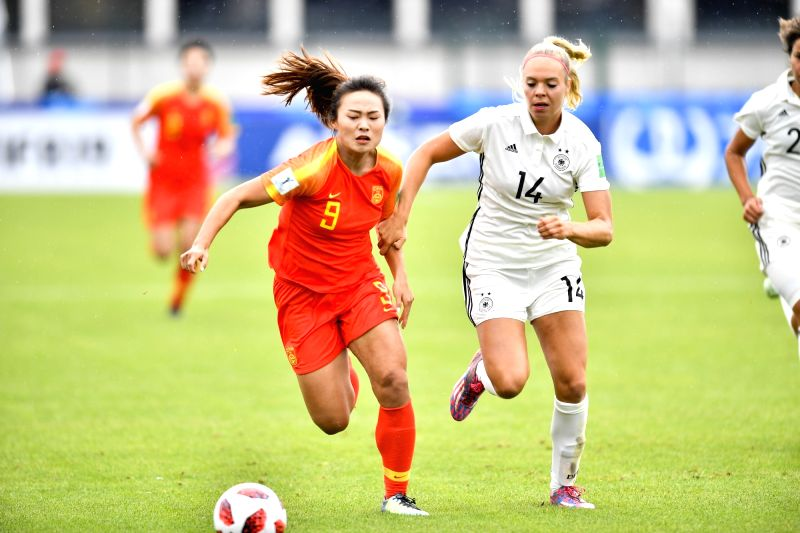SAINT-Jin Kun (front L) of China vies with Janina Hechler of Germany during a Group D match at the FIFA U-20 Women's World Cup France 2018 in Saint-Malo, France on Aug. ...