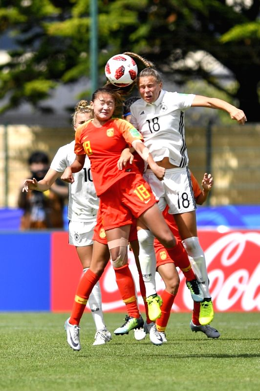 SAINT-Yang Qian (Front L) of China vies with Klara Buehl (Front R) of Germany during a Group D match at the FIFA U-20 Women's World Cup France 2018 in Saint-Malo, ...