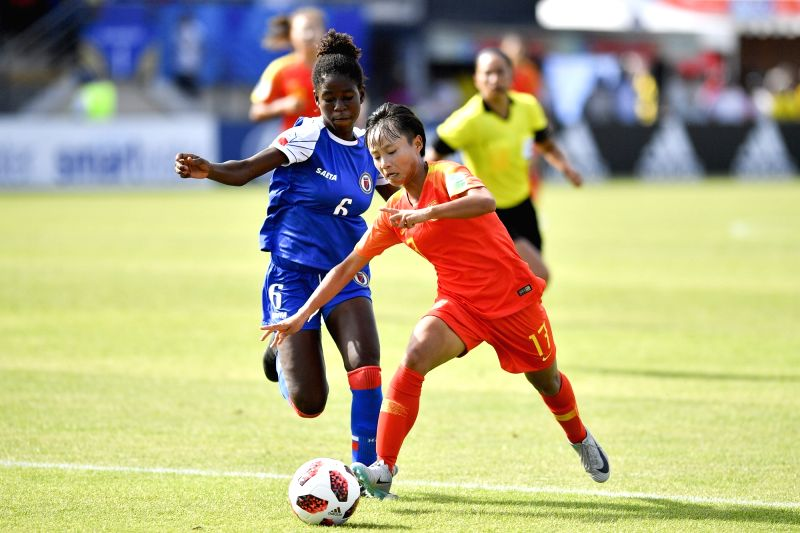 SAINT-Zhang Linyan (R) of China vies with Dougenie Joseph of Haiti during the Group D match of 2018 FIFA U-20 Women's World Cup in Saint-Malo, France on Aug. 6, 2018. ...