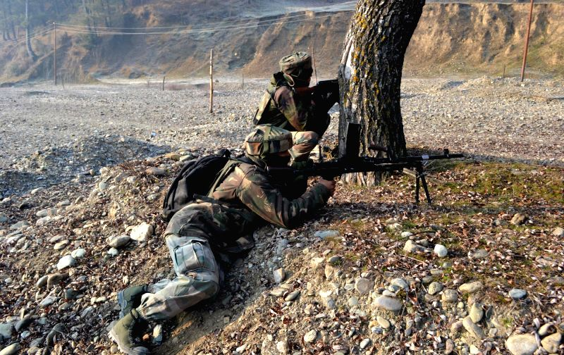Salkoot : Soldiers take position during an encounter with militants in Kupwara district of Jammu and Kashmir on Dec 18, 2014.