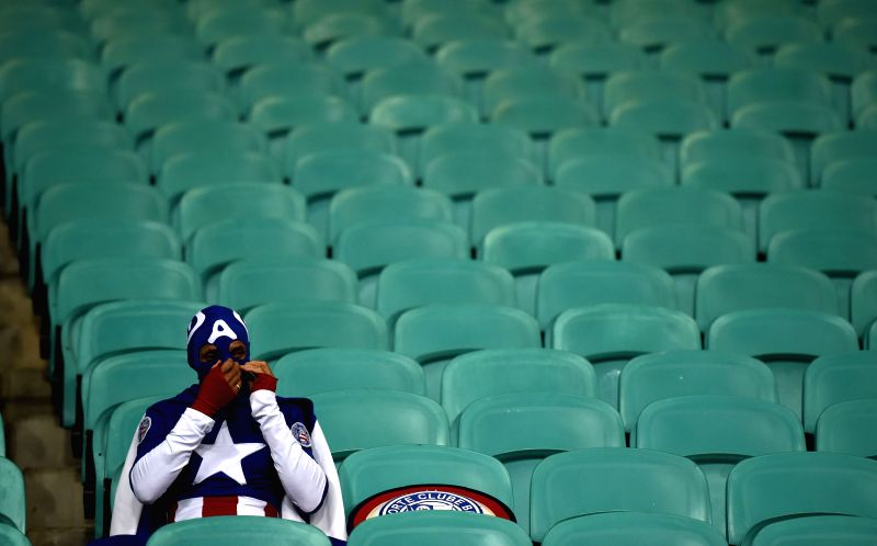 A Fan of the U.S. stays on the stand after a Round of 16 match between Belgium and the U.S. of 2014 FIFA World Cup at the Arena Fonte Nova Stadium in Salvador, ...